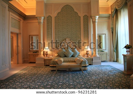 ABU DHABI, UAE - MAY 26: Palace suite bedroom interior of Emirates Palace hotel on May 26, 2011. Emirates Palace is a luxurious 7 star hotel designed by renowned architect, John Elliott RIBA.