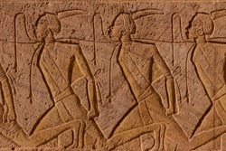 Abu Simbel carvings slaves. Carving of bound slaves near the entrance to the temple complex of Abu Simbel, Egypt
