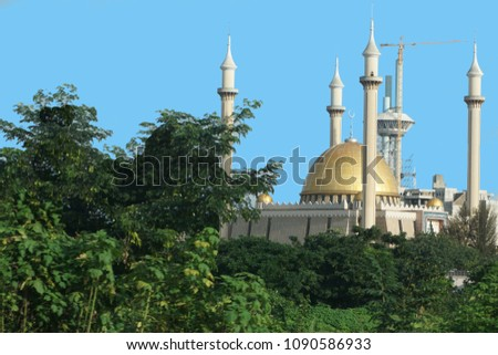 Abuja's National Mosque is the biggest mosque in Nigeria and West Africa. Built in 1984 in the capital city, Abuja, Nigeria. The mosque is where Muslims pray 5 times a day. It has also 4 minarets. #1090586933