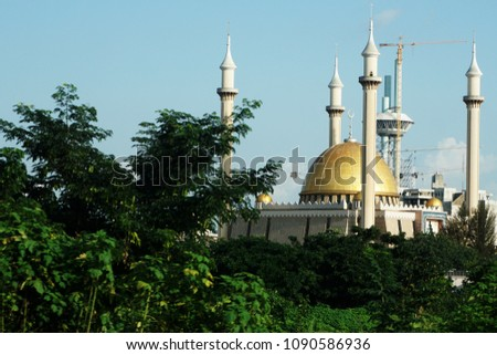 Abuja's National Mosque is the biggest mosque in Nigeria and West Africa. Built in 1984 in the capital city, Abuja, Nigeria. The mosque is where Muslims pray 5 times a day. It has also 4 minarets. #1090586936
