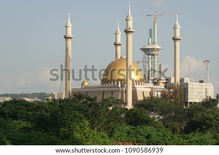 Abuja's National Mosque is the biggest mosque in Nigeria and West Africa. Built in 1984 in the capital city, Abuja, Nigeria. The mosque is where Muslims pray 5 times a day. It has also 4 minarets. #1090586939