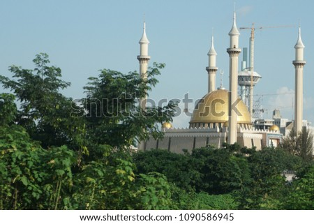 Abuja's National Mosque is the biggest mosque in Nigeria and West Africa. Built in 1984 in the capital city, Abuja, Nigeria. The mosque is where Muslims pray 5 times a day. It has also 4 minarets. #1090586945