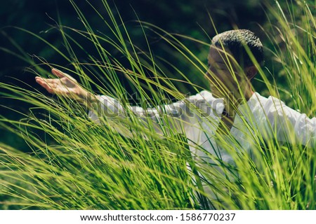 Abundance in Springtime, Woman with Open Arms, Connected with Nature, Enjoying Life Stock photo ©