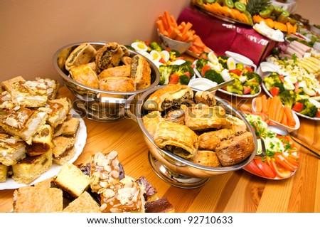 Abundance of food on the table - stock photo