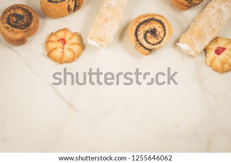 abundance of pastries on a white background/abundance of pastries on a white background, top view and copy space