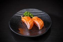 Aburi Salmon Nigiri, Salmon Sushi and topped with Salmon Eggs served on ceramic dish, Japanese food style, Japanese menu, selective focus