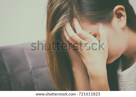 Abuse ,Woman sit alone feeling bad , Emotional girl depressed , violence concept.