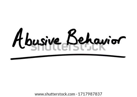 Abusive Behavior handwritten on a white background. Photo stock ©