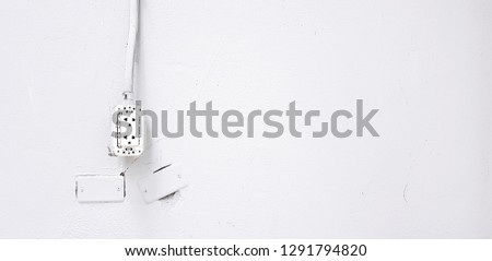 AC (Alternating Current) outlet with electrical wire or cable installed on gray concrete wall and copy space - Industrial, Electricity, Plug, Wallpaper and Background concept