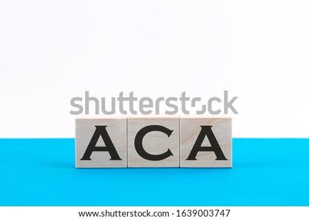 ACA Affordable Care Act acronym on wooden cubes Imagine de stoc ©