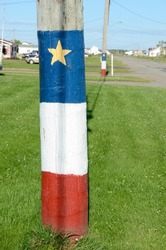 Acadian flag painted on a telephone pole, new brunswick, canada