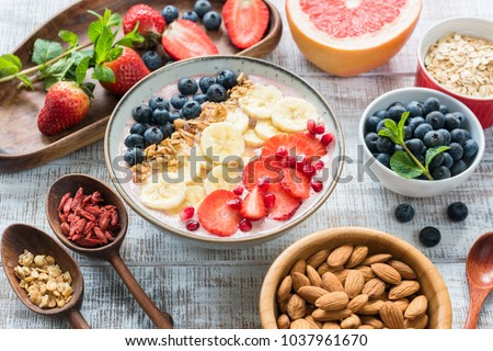 Acai Smoothie bowl with granola, banana, strawberry and blueberries. Superfood. Concept of healthy eating, healthy lifestyle