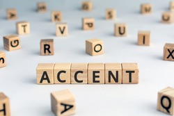 accent - word from wooden blocks with letters, the way to  pronounce words accent concept, random letters around, white  background