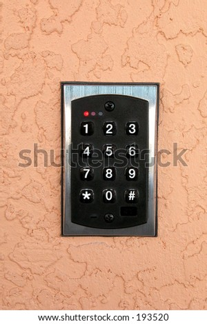 access keypad mounted on a stucco wall