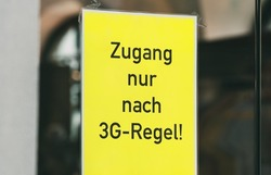 Access only after 3 G rule, sign on the door of a store or restaurant. Covid-19 protection measure, access only for people who are tested, vaccinated or recovered