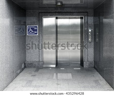 Accessible Elevator with sign and marble structure aisle, nobody #435296428