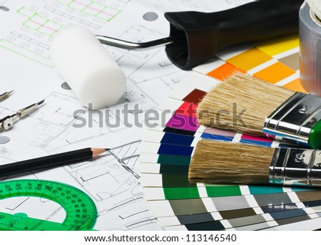 accessories and tools for home renovation are on architectural drawings
