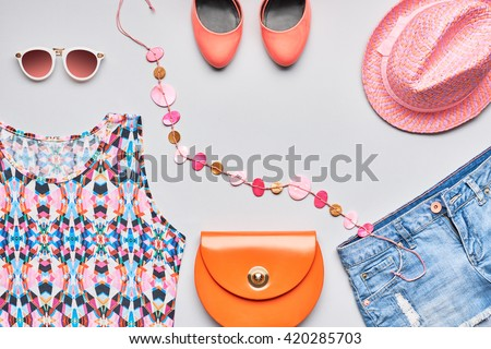 Accessories clothes fashion set. Stylish woman accessories, handbag clutch, pink top, denim, glamor orange shoes, trendy necklace, hat sunglasses. Summer outfit