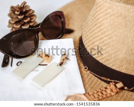Accessories Flatlay includes accessories, sunglasses, hat and a watch