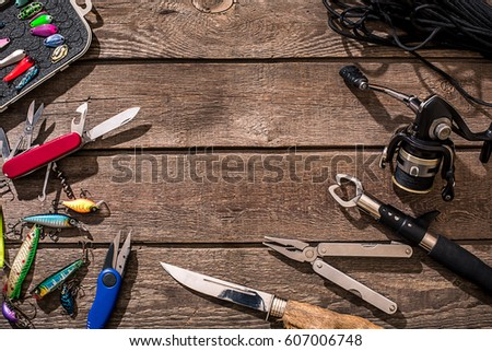 Accessories for fishing on the background of wood. Top view #607006748
