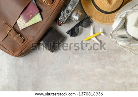 Accessories for travel plan, trip vacation, tourism - vintage bag and vintage camera on marble background. Flat lay and copy space #1370816936