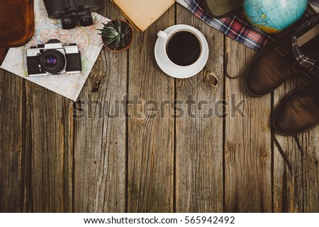 Accessories for travel top view on wooden background with copy space. Adventure and wanderlust concept image with travel accessories. Preparing for an exotic trip, journey and sightseeing. #565942492