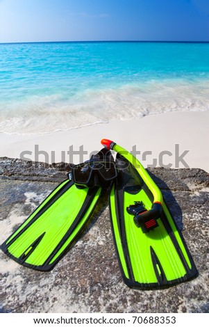 Accessory for Snorkeling -mask, flippers,  tube-lay on sand on background of ocean - stock photo