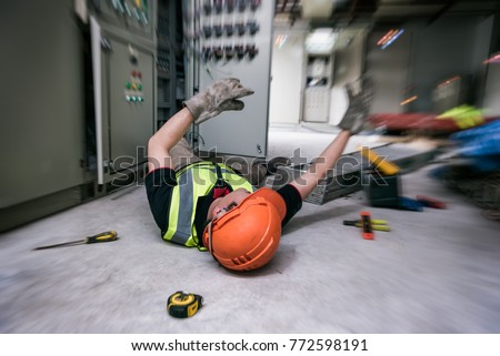 Accident at work of electrician job or Maintenance worker in the control room of factory. Add zoom filter effect for feelings.