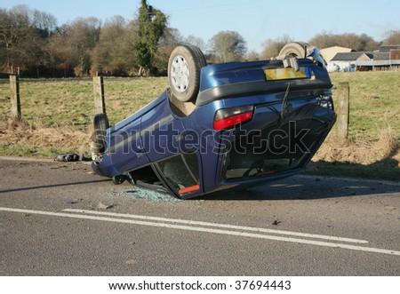 Accident Crash Hatchback Car on Roof