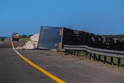 accident on the road overturned truck semi-trailer with cargo