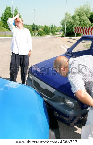 accident two cars, two mans looks at vehicle