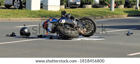 Accident with motorcycle at a crossroads Stock photo ©