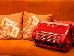 Accordion on a sofa