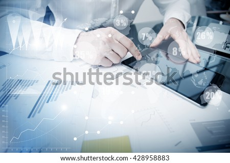 Account Department Work Online Process.Photo Trader working Market Report Documents Touching Screen Tablet.Using Graphics,Stock Exchanges Reports,Digital Interfaces.Business Project Startup.Horizontal