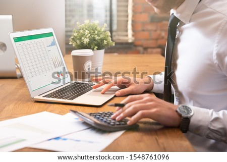 Accountant calculate tax information or business data. Businessman working in office Сток-фото ©