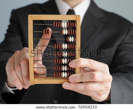accountant calculating with wooden numerator
