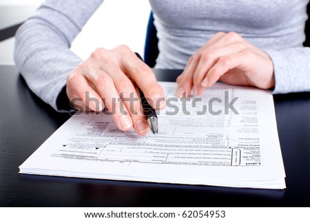 Accountant filling the documents out.