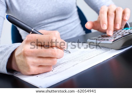 Accountant filling the forms out.
