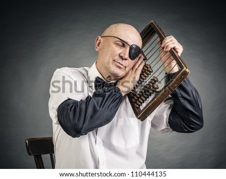 accountant one-eyed and a old abacus