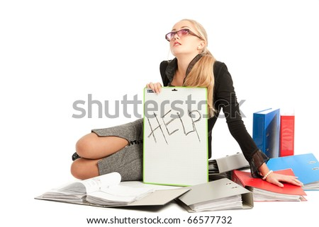 accountant siting near to stack of files