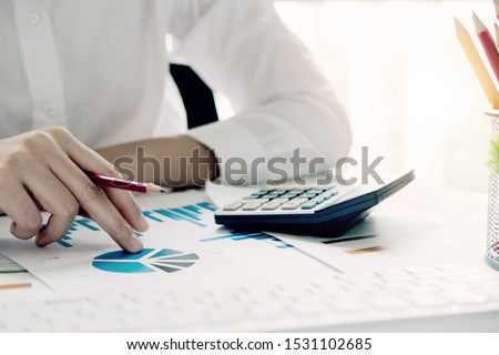 Accountant using a calculator to calculate the numbers. Accounting , Accountancy from financial report and calling to consultant, Calculation Concept.