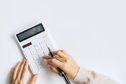 Accountant using calculator on desk office on white background with copy space, Top view
