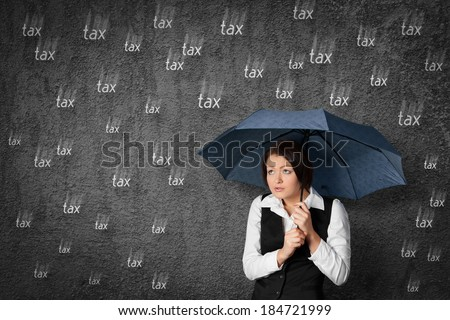 Accountant woman has fear of the tax. Worried businesswoman hide under umbrella against raining tax.