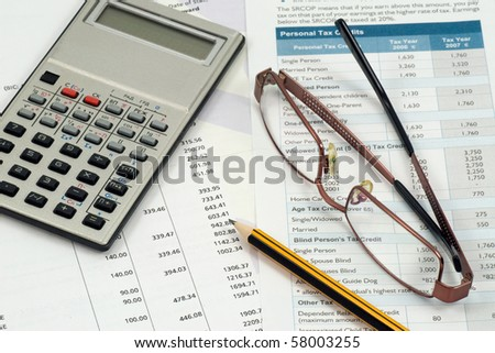 accountant  work space. statement,calculations and expenses