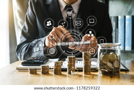 accountant working on desk in office using calculator and smartphone to calculate budget. concept finance and accounting with VR icon in morning light