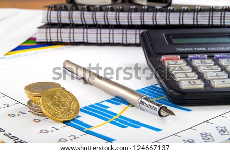 accounting. business plan, coins, pen and calculator