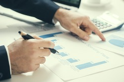 Accounting. Businessman with charts on table