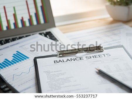 accounting concept. balance sheet and business earning report on desk.