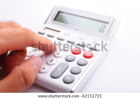 accounting concept with calculator and pen in business office - stock photo