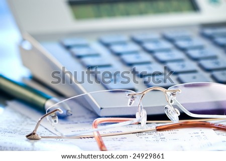 accounting concept with calculator glasses and pen for business balance